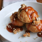 Profiteroles with Tahini Brown Butter Cream, Sesame Cashews, Caramel and Halva